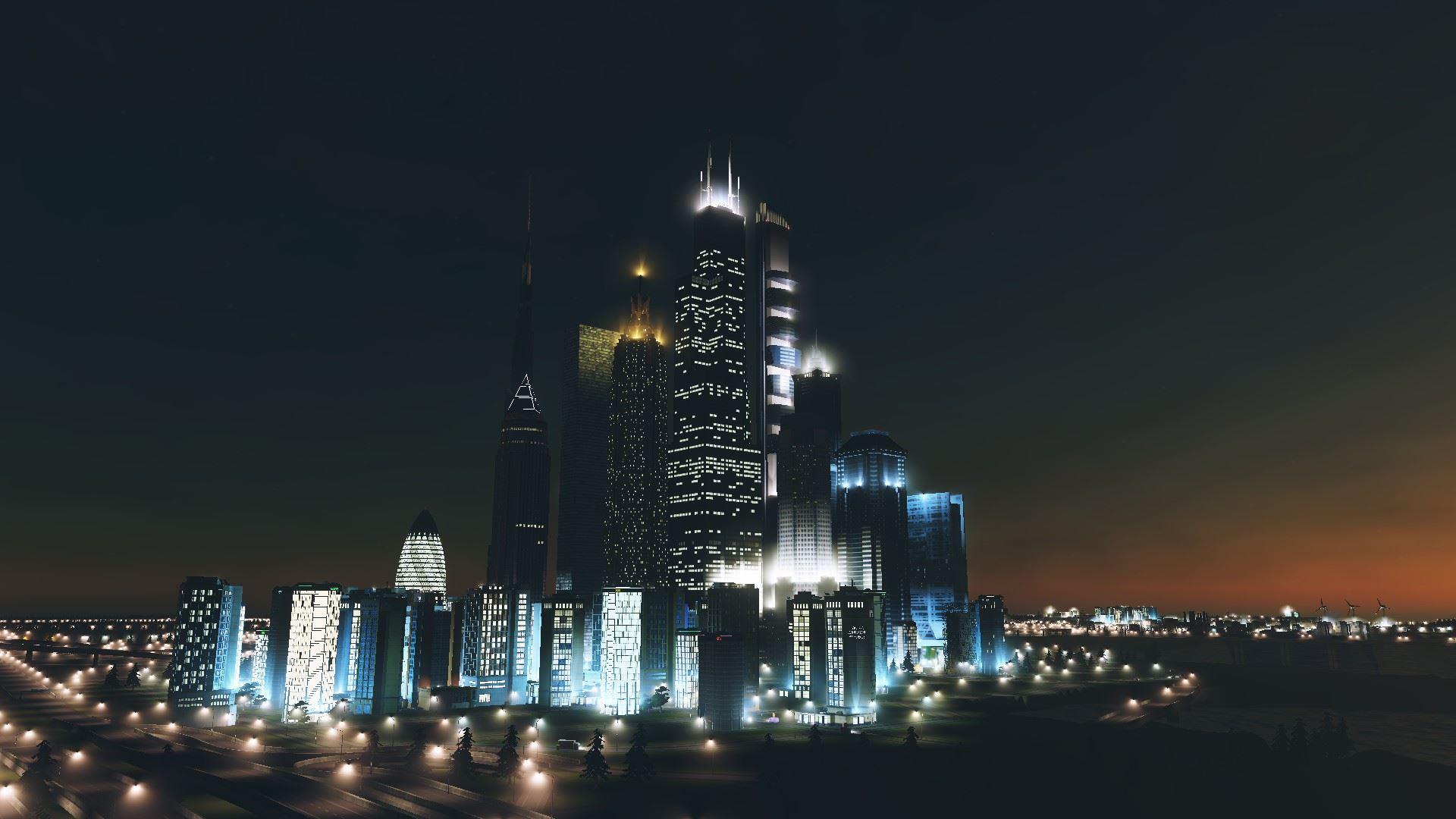 Screenshot aus Cities Skylines: Die Skyline der Stadt bei Nacht.