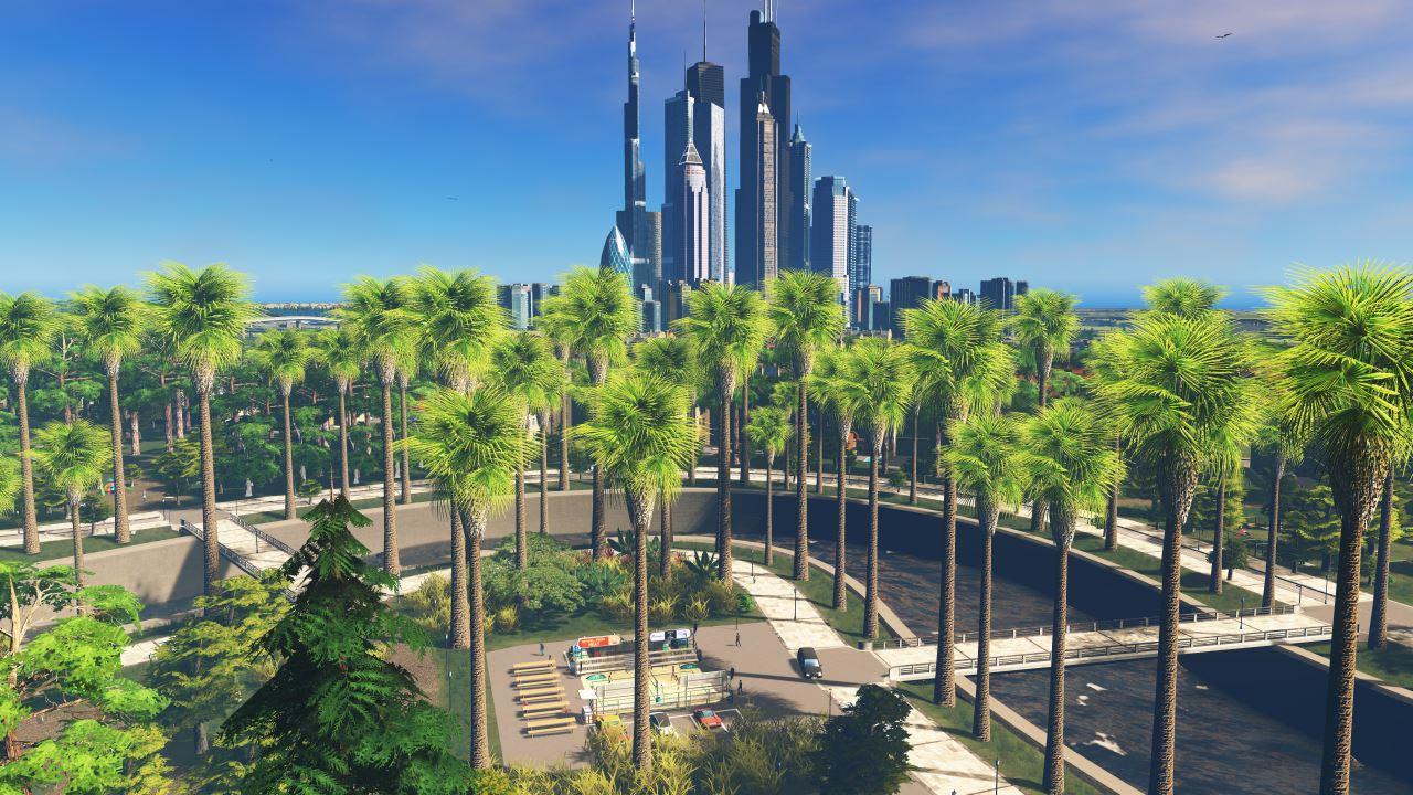 """Screenshot aus Cities Skylines: Blick auf den """"Central Park"""". Im Hintergrund ist die Skyline zu sehen."""
